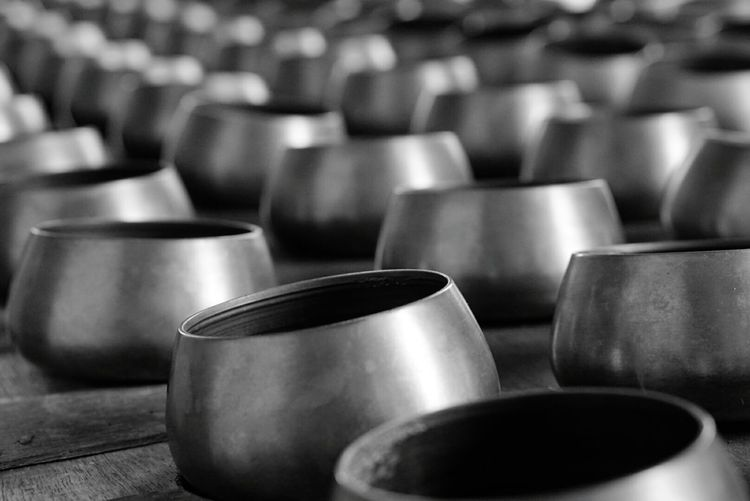 Metallic Bowls On Table At Factory