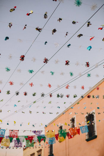 Low angle view of decorations hanging on wall