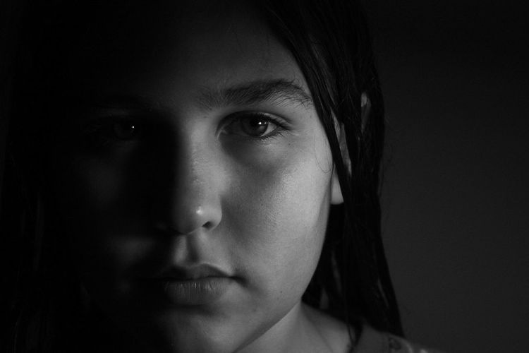 Portrait Headshot Looking At Camera Close-up One Person Human Body Part Indoors  Real People Front View Human Face Body Part Young Adult Women Young Women Lifestyles Serious Child Females Depression - Sadness Black Background EyeEmNewHere
