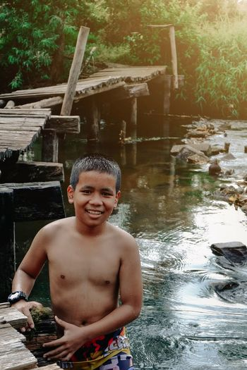 Portrait of shirtless boy in water