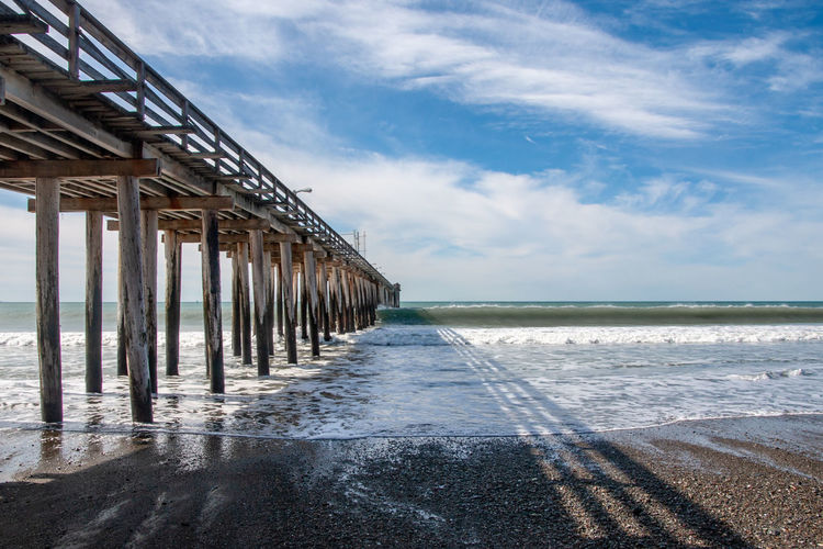 The wooden pier at Pismo Beach along the Californian coast Pismo Pismo Pier Architectural Column Architecture Beach Beauty In Nature Built Structure Cloud - Sky Day Horizon Horizon Over Water Land Nature No People Outdoors Pacific Coast Pacific Ocean Pier Scenics - Nature Sea Sky Tranquil Scene Tranquility Water Wooden Post