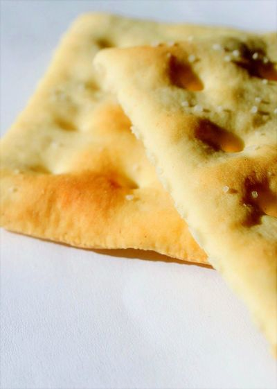 Crackers Food Close-up No People Ready-to-eat Day Saltine White Background Shadow Full Frame Focus On Foreground