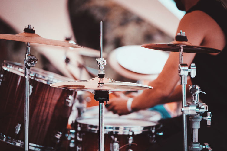 Unidentified drummer playing on drum kit. Close up of play drums. Drum player kick drum plate. Man playing drums music Artist Arts Culture And Entertainment Close-up Cymbal Drum Drum - Percussion Instrument Drum Kit Drums Focus On Foreground Indoors  Music Musical Equipment Musical Instrument Musician Nightlife Occupation One Person Percussion Instrument Playing Real People Selective Focus Skill