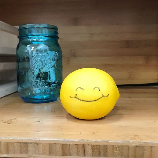 EyeEm Selects Yellow Indoors  Table Food Still Life Container Indoors  Food And Drink Jar Anthropomorphic Smiley Face Lemon
