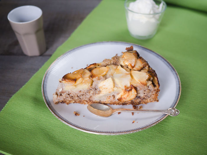 Delicious slice of apple walnut cake with a cup of italien coffee Apple Apple Cake Baked Pastry Item Bakery Birthday Cake Calories Carbohydrates Coffee Coffee Time Delicious Dessert Green Background Indulgence No Diet Pastry Snack Sweet Sweet Food Sweetness Tasty Temptation Unhealty Food Walnut Whipped Cream