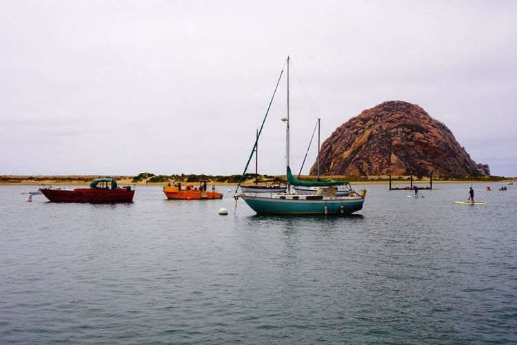Nautical Vessel Fresh On Eyeem  Mode Of Transport Boat Water Sea Waterfront Sailboat Mountain Mast Tranquil Scene Calm Tranquility Sky Nature Sailing Scenics Day Outdoors Ocean Morro Bay Morro Bay, California Harbor Tranquility Colors