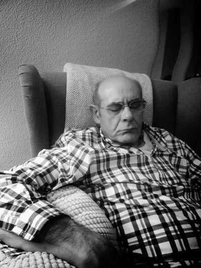 Man wearing eyeglasses at home