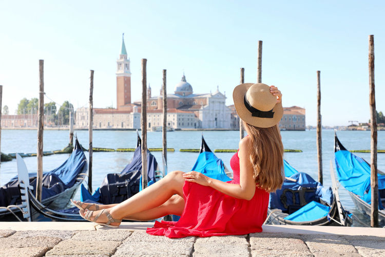 Side view of young woman wearing hat looking at st marks square