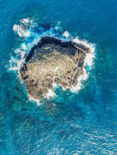 Aerial drone view of the Sugar Loaf, an isolated and remote small rock and part or the Admiralty Islands off the coast of Lord Howe Island in the Tasman Sea, New South Wales, Australia. Lord Howe Island Lord Howe Island Rock - Object Australia Remote Isolated Tasman Sea Lonely Loneliness Backgrounds Admiralty Islands New South Wales  Aerial View Drone View High Angle View Water Ocean Pacific Rough Waves Strong Strength Islet Beauty In Nature Nature Turquoise Colored No People Sea