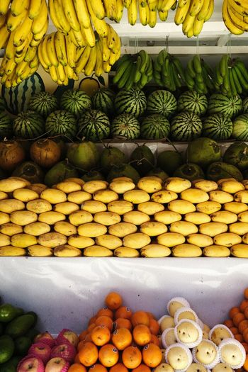 Fruits Stack Market Arrangement Heap Variation Retail  For Sale Food And Drink Stall Farmer Market Market Stall Coconut Mango Street Market Retail Display Assortment Various