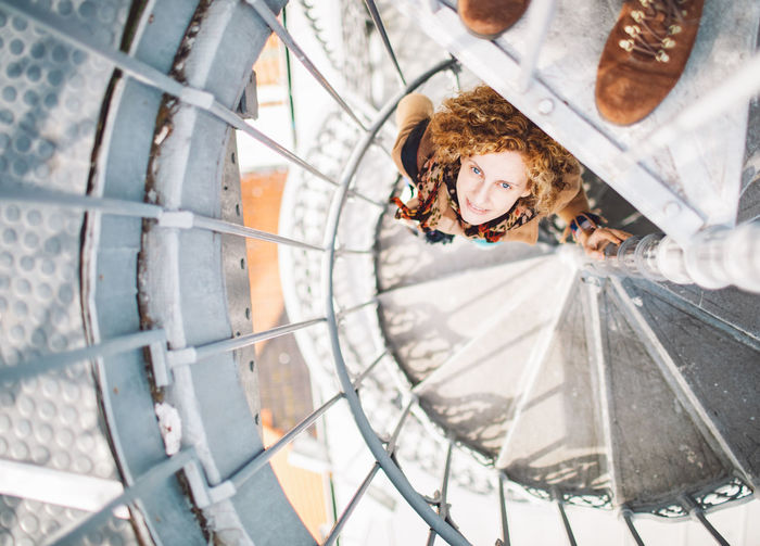 Portrait of woman standing on spiral staircase