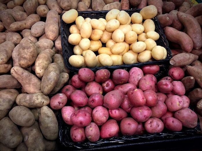 Abundance of potatoes on market stall
