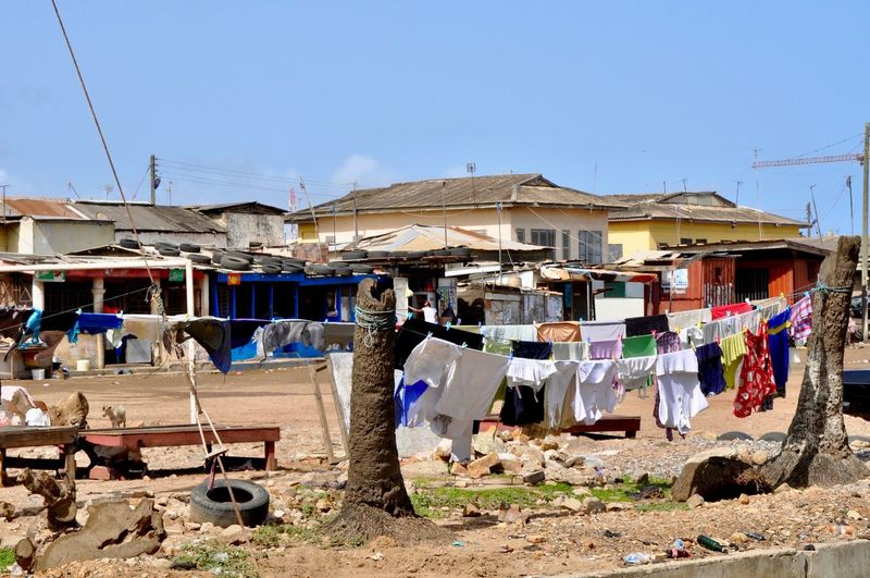 Clothes drying on clothesline by building against clear sky