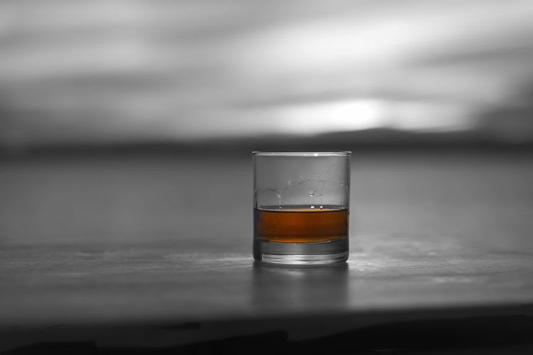 Selective color whiskey by the sea solo hero Al Fresco Alcohol Bourbon Cruise Dram Drink Gambling Glass Golden Gray HERO Liquor Masculine Ocean Outside Sailing Scotch Sea Selective Color Solo Sunset Whiskey Wooden Table