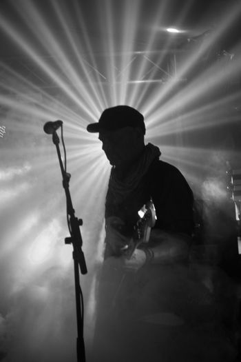 Low angle view of silhouette man holding illuminated stage at night