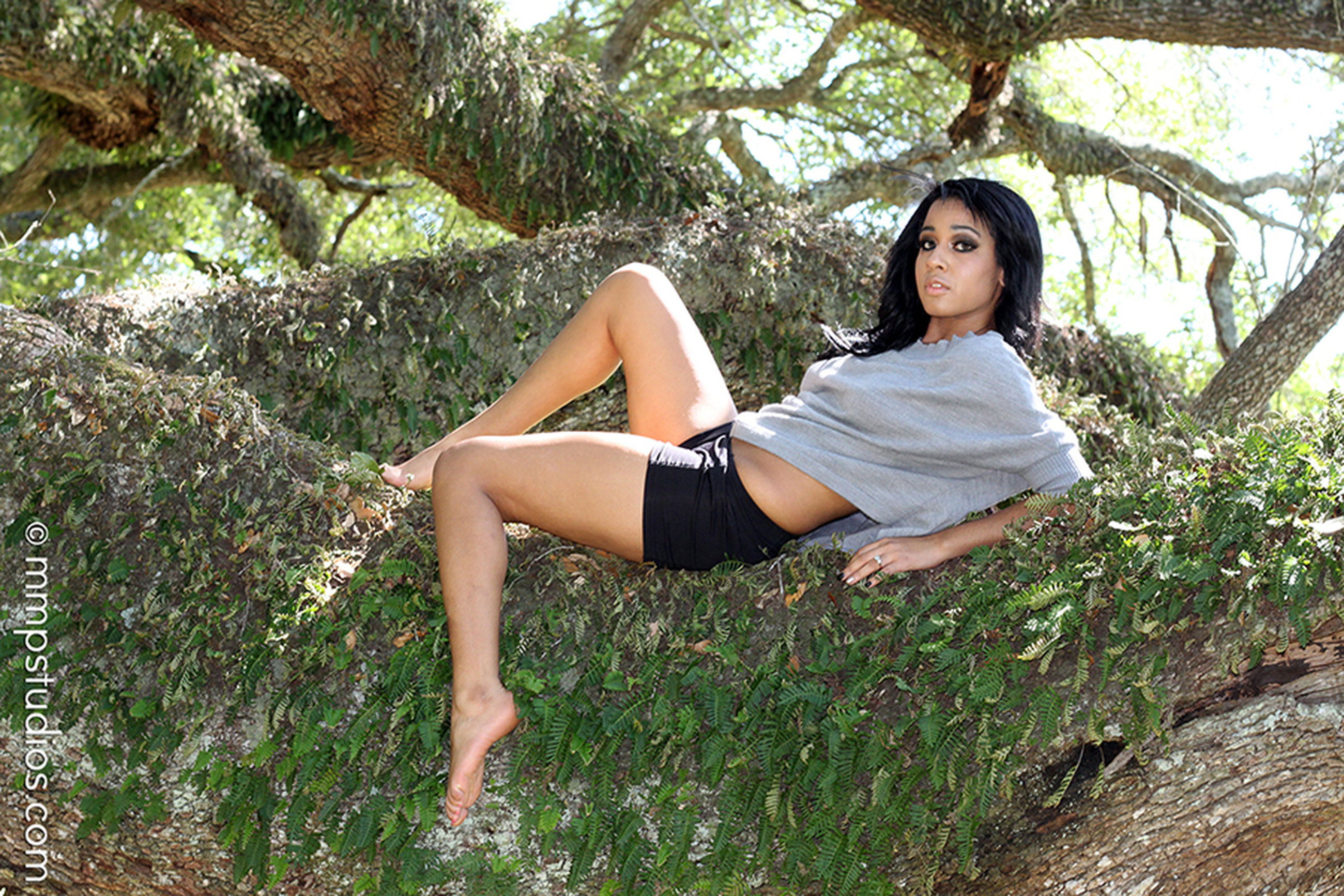 young adult, plant, young women, one person, lifestyles, leisure activity, real people, looking at camera, full length, tree, casual clothing, portrait, nature, day, relaxation, land, growth, hairstyle, hair, beautiful woman, outdoors