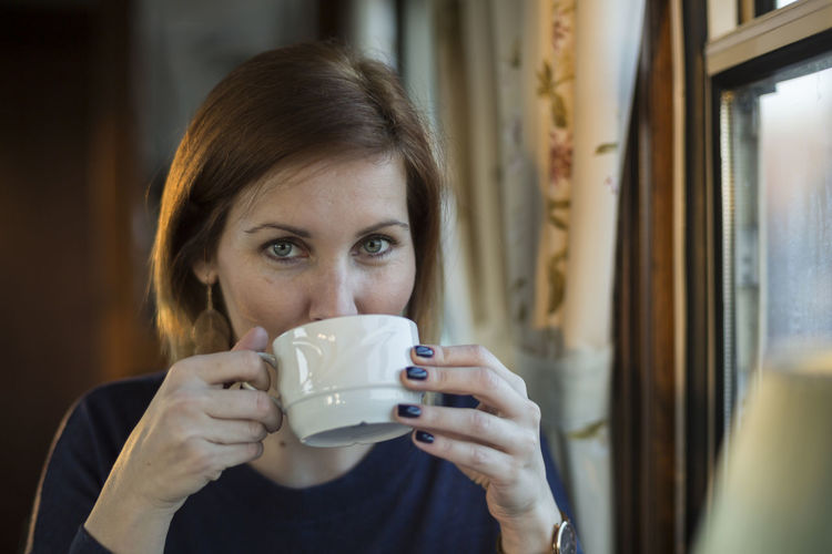 [Cosinon 55mm f/1.2 MC] Always Be Cozy Coffe Coffee Break Coffee Time Coffee ☕ Contemplation Dining Car Girl Girlfriend Happy Happy Day Lifestyles Natural Light Portrait Person Portrait Of A Woman Real People Tea Tea Time Train Woman Young Adult Liquid Lunch Women Who Inspire You