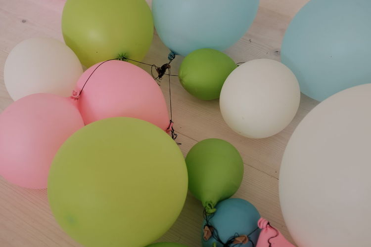 Ball Balloon Balloons Close-up Colorful Colors Colorsplash Freshness Green Color Group Of Objects In A Row Indoors  Large Group Of Objects Multi Colored No People Order Party Party Time Still Life Strinf Variation Wooden Texture