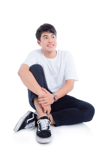 Boy Asian  Thai Sitting White Isolated Background Full Length Smile Handsome Teen Teenager Adult Education Student College Man Male Happy Guy