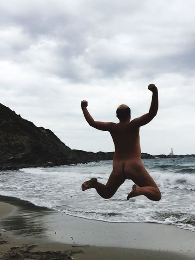 Freedom Jumping Jump Lighthouse_lovers Lighthouse Naked_art Naturism Nakedhuman Water Sky Sea Beach Land Lifestyles One Person Cloud - Sky Beauty In Nature EyeEmNewHere A New Beginning