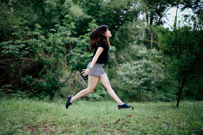 Start the Monday jumping: checked. Carefree Casual Clothing Fresh Girl Green Happiness Jump Jumping Nature Rainy Days Real People Women Young Women