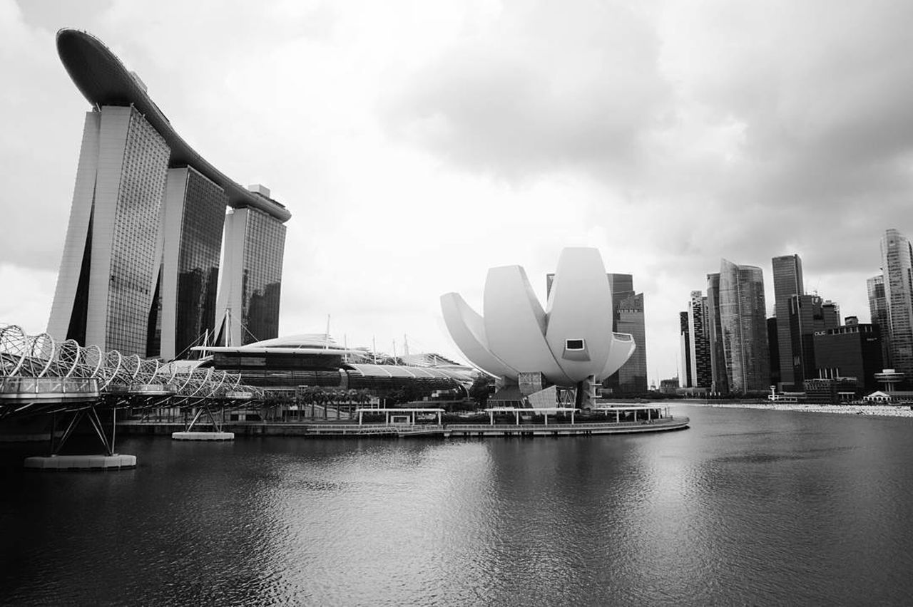 architecture, building exterior, skyscraper, built structure, city, modern, cityscape, waterfront, urban skyline, downtown district, travel destinations, water, city life, nautical vessel, outdoors, sky, day, no people, luxury hotel