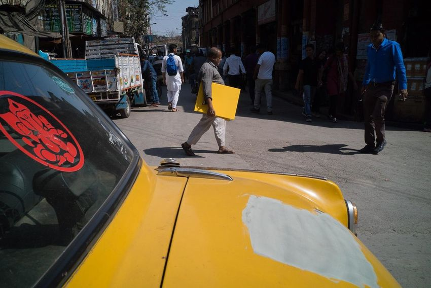 Kolkata 2017 India Kolkata Car City Day Lifestyles Men Outdoors People Puzzle  Real People Streetphotography Thief Transportation Urban Yellow Paint The Town Yellow