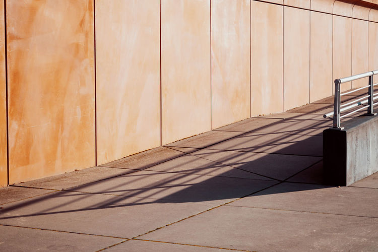 Minimalism Minimalobsession Architecture Built Structure No People Day Pattern Orange Color Sunlight Shadow Wall - Building Feature Wood - Material Flooring Nature Outdoors Building Exterior Absence Footpath Brown Tile Wood Sunny Security Tiled Floor Focus On Shadow