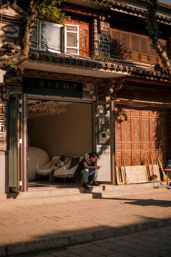 Man outside temple against building