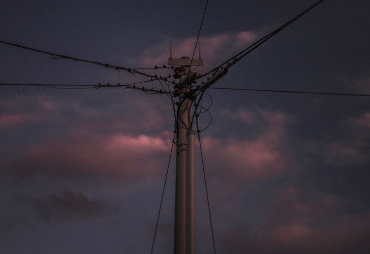 Sky Electricity  Cable Cloud - Sky Connection Low Angle View Power Line  Fuel And Power Generation Technology Power Supply Electricity Pylon No People Nature Sunset Pole Dusk Silhouette Outdoors Dramatic Sky Complexity Telephone Line Electrical Equipment