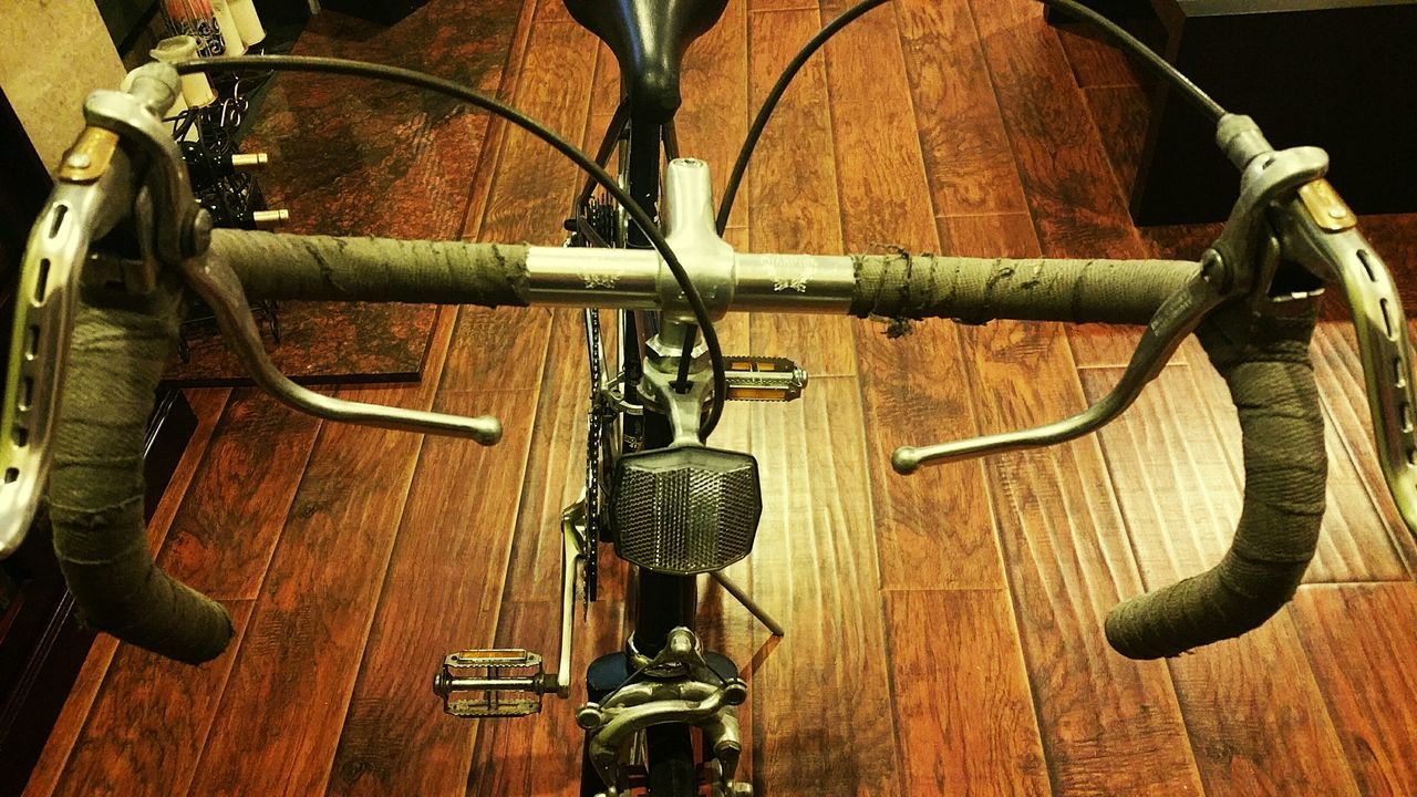 High Angle View Of Vintage Bicycle On Wooden Floor