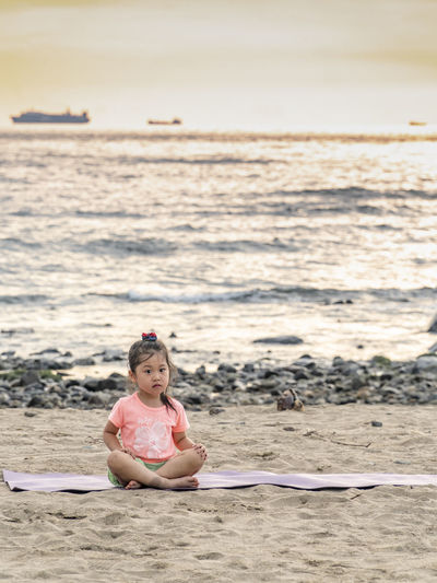 Child Childhood Sea Beach Sitting Full Length Girls Sand Smiling Pink Color