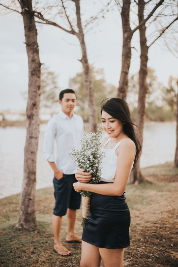 couple Prewedding Preweddingphoto Flower Couple - Relationship Husband And Wife Young Women Togetherness Women Standing Full Length Technology Happiness Tree Men Friendship Couple Hugging