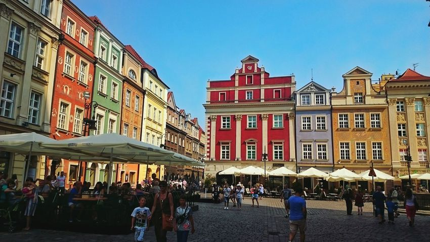 Red Building Exterior City Architecture Store Travel Destinations Outdoors Crowd Day Sky Old Architecture Old Town Old Buildings Warmth Summer EyeEmNewHere Cityscape City Built Structure Poland