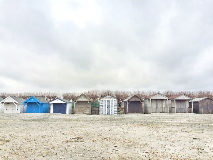 Beach huts against clouds