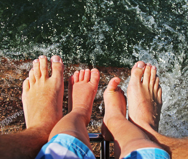 Barefoot Beach Boat Boating Bonding Child Family Father Fatherhood  Feet High Angle View Human Foot Leisure Activity Lifestyles Low Section Men Outdoors Part Of Person Personal Perspective Relaxation Toes Togetherness Water