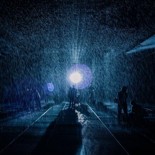 People on illuminated airport runway