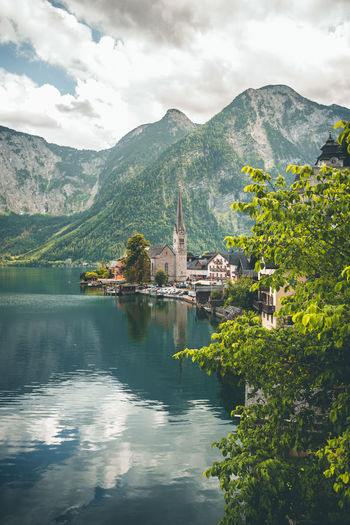 Beautiful view over The Evangelical Church of Hallstatt, Austria Church Evangelical Kirche Architecture Beauty In Nature Belief Building Building Exterior Built Structure Cloud - Sky Day Hallstatt Mountain Mountain Range Nature No People Outdoors Place Of Worship Plant Reflection Religion Scenics - Nature Sky Tree Water
