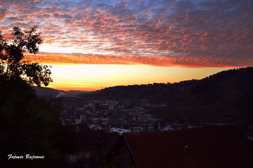 Awakening of a new day Architecture Beauty In Nature Built Structure City Cityscape Cloud Cloud - Sky Dramatic Sky Idyllic Landscape Mountain Nature No People Orange Color Outdoors Residential Building Residential District Residential Structure Scenics Sky Sunset Town TOWNSCAPE Tranquil Scene Tranquility