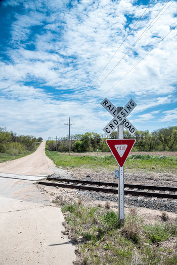 Cloud - Sky No People Outdoors Railroad Crossing Railroad Track Railway Signal Road Road Sign Sky Transportation