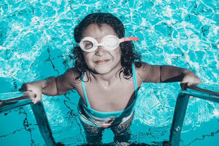 High angle portrait of girl in swimming pool