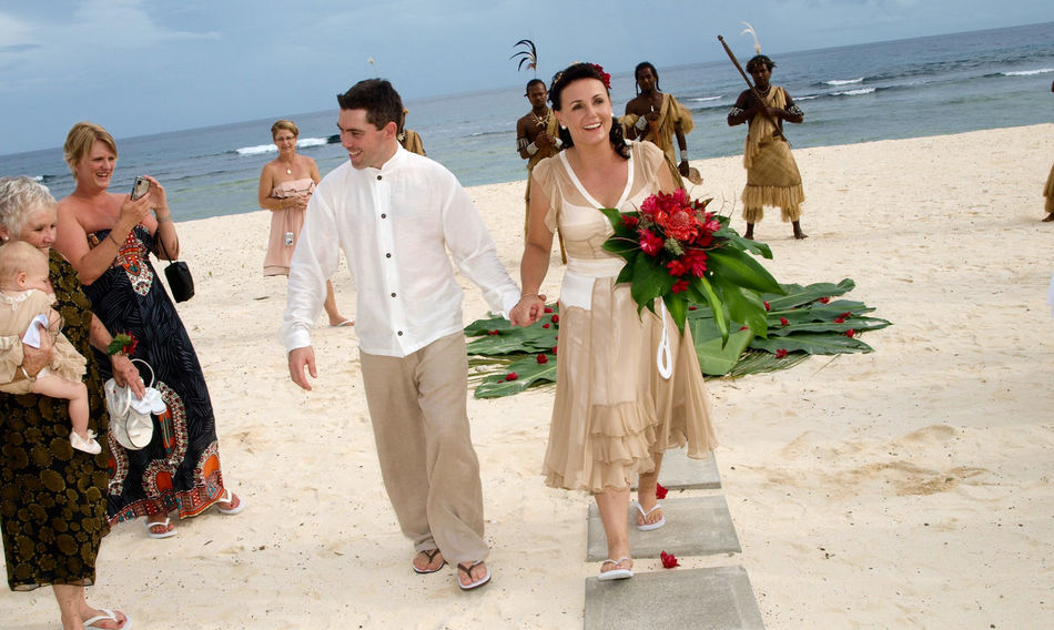 Beach Wedding Port Vila, Vanuatu Beach Wedding Port Vila, Vanuatu Bride And Groom, Grooms Hand, Brides Hand, Love, Couple, Newlyweds, French Cuff, Bridal Bouquet Casual Clothing Day Full Length Leisure Activity Lifestyles Pacific Ocean Person Sky Standing Togetherness Vacations Young Adult