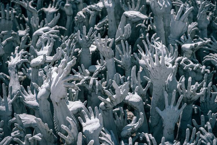 Full frame shot of human hand sculptures