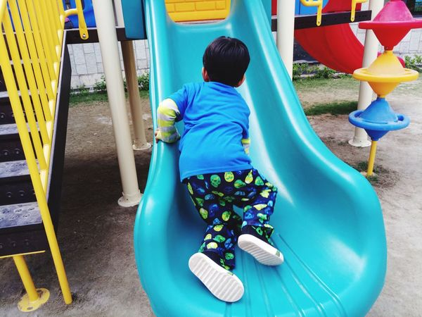 EyeEm Selects Rear View One Person Full Length People Real People Outdoors Day Childhood Child Playground Equipment Playground Slide Close-up Outdoor Play Equipment Playground Multi Colored Kid Kids At Play Playing Play