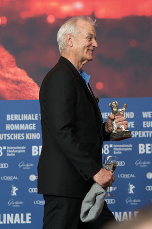 Berlin, Germany - February 24, 2018: Bill Murray, accepting the award for Wes Anderson (winner of the Silver Bear for Best Director for 'Isle of Dogs'), at the Berlinale Award Winners press conference AWARD Artist Berlin Best Director Event Film Festival Press The Media Winning Arts Culture And Entertainment Berlinale Berlinale 2018 Berlinale2018 Berlinale68 Bill Murray Entertainment Entertainment Event Film Industry Mass Media One Person Press Conference Side View Silver Bear Standing Winner