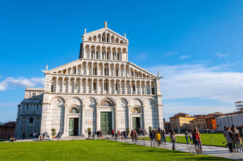 The Cathedral dedicated to Santa Maria Assunta, in Piazza dei Miracoli in Pisa. UNESCO World famous site, located in beautiful Tuscany Architecture Built Structure Building Exterior Sky Group Of People Large Group Of People Crowd Nature Travel Destinations Real People Tourism Women Day Travel Blue History Grass Lawn Men Outdoors Pistil Piazza Dei Miracoli Tower Learning Pisa Pisa Tower Pisa Cathedral