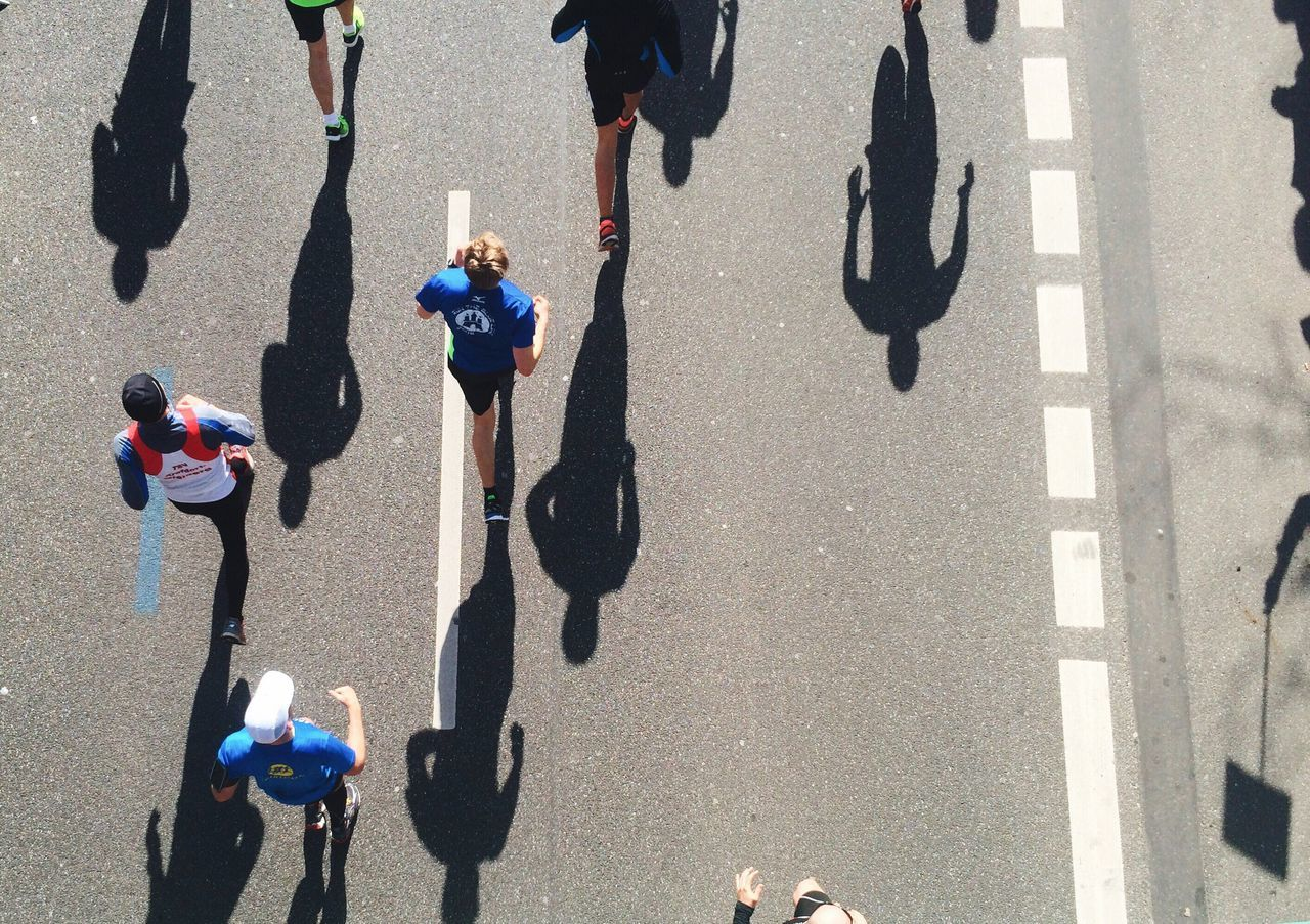High angle view of athletes running on street during marathon