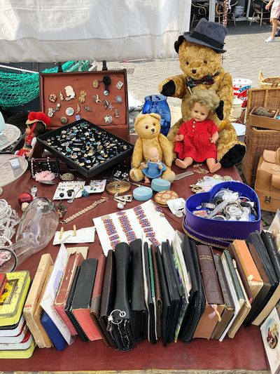 Doll Teddy Bear Books Flea Market Antique Old Things Choice Multi Colored Variation Abundance No People Still Life High Angle View Large Group Of Objects Arrangement For Sale Retail  Day Collection Small Business Table Market