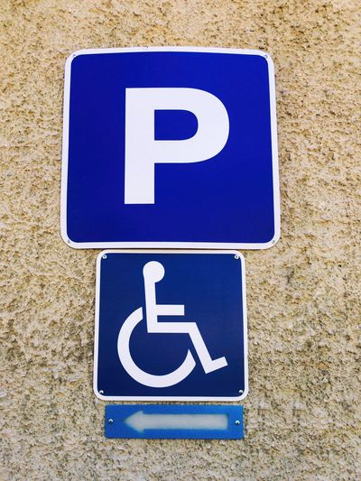 Disabled Parking Sign Disabled Parking Sign Parking Sign Road Sign Disabled Sign Disabled Parking Wheelchair Arrow Symbol Blue Accessibility Reserved Parking Symbol Wheelchair Access Wheelchair Sign Wall - Building Feature Care No People Outdoors Parking Area Disability  Hospital Traffic