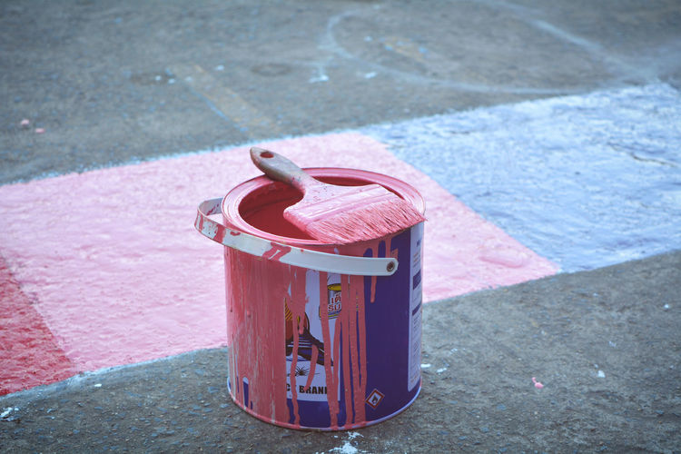 City Close-up Container Day Focus On Foreground Footpath High Angle View Metal No People Outdoors Paint Bucket Pink Color Plastic Red Road Safety Sidewalk Single Object Street